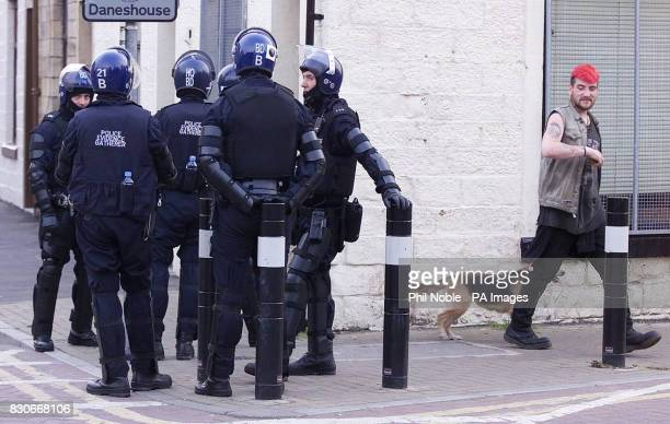 Police officers in full riot gear as they try to maintain calm on the street's of Burnley Lancashire after a weekend of violence Shops and a pub were...