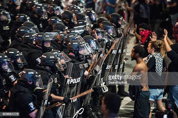Police officers in riot gear approach demonstrators September 21 2016 in downtown Charlotte NC Protests in Charlotte began on Tuesday in response to...