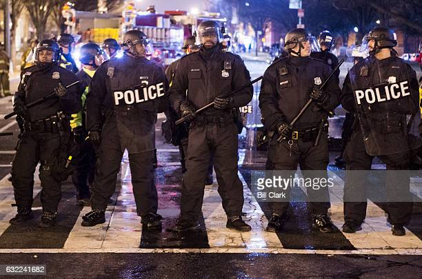 Police officers in riot gear black K Street at 14th Street as antiTrump protesters continue their protests into the night following a day of unrest...