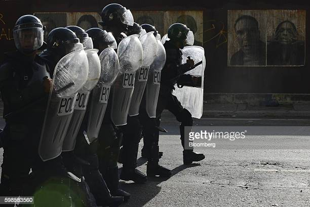 Police officers in riot gear confront protesters in Caracas Venezuela on Thursday Sept 1 2016 Hundreds of thousands of Venezuelans demonstrated in...