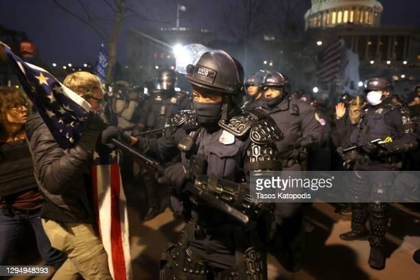 Police officers in riot gear confront protesters who are gathering at the U.S. Capitol Building on January 06, 2021 in Washington, DC. Pro-Trump...