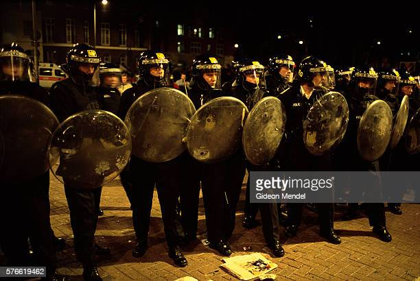 police officers in riot gear in london - riot shield stock pictures, royalty-free photos & images