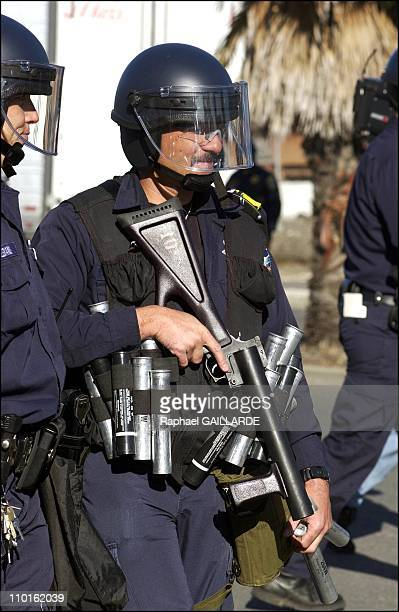Police officers in riot gear just after they opened fire with nonlethal weapons at more than 500 hundred antiwar protesters who gathered at the port...