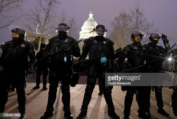 Police officers in riot gear line up as protesters gather on the U.S. Capitol Building on January 06, 2021 in Washington, DC. Pro-Trump protesters...