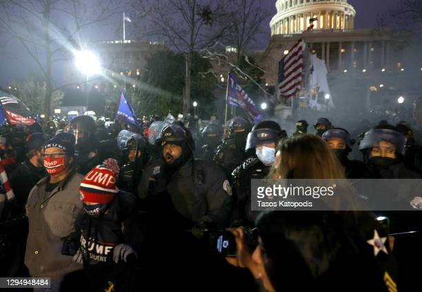 Police officers in riot gear move protesters who are gathering at the U.S. Capitol Building on January 06, 2021 in Washington, DC. Pro-Trump...