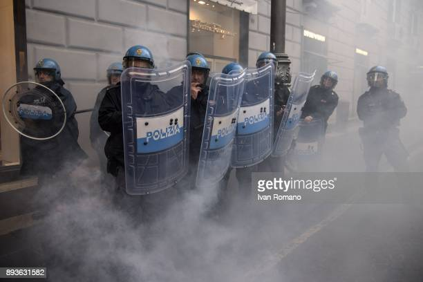 Police officers in riot gear near the Confcommercio during students demonstration in the streets of Naples against the General States of the school...