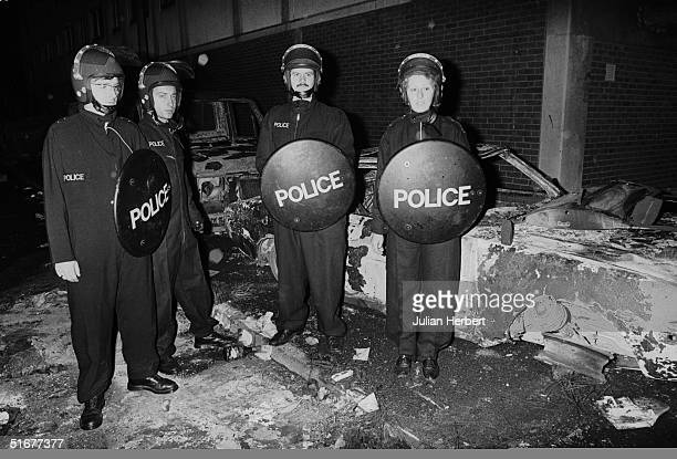 Police officers in riot gear on the Broadwater Farm housing estate Tottenham London after the riot of 6th October 1985