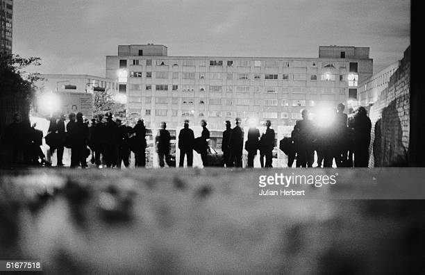 Police officers in riot gear on the Broadwater Farm housing estate Tottenham London the morning after the riot of 6th October 1985 The racial...
