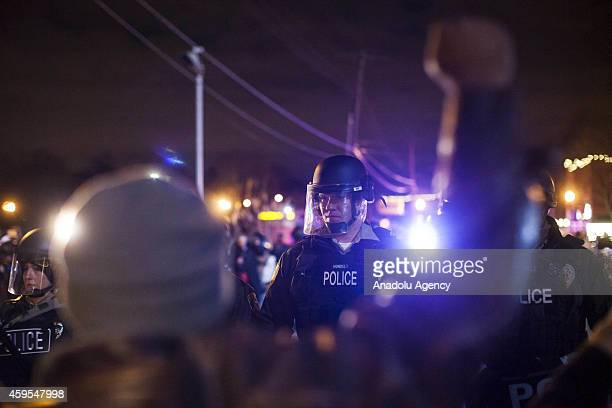 Police officers in riot gear stand guard after grand jury's decision was delivered on November 24 2014 in Ferguson Missouri United States The grand...