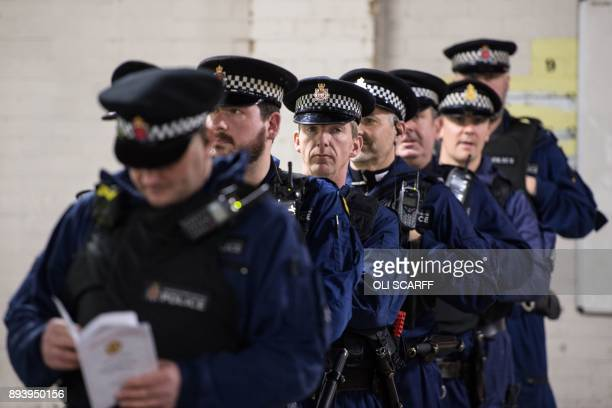 Police officers in Stretford Police Station receive a briefing in the station's garage area prior to the UEFA Champions League group A match between...