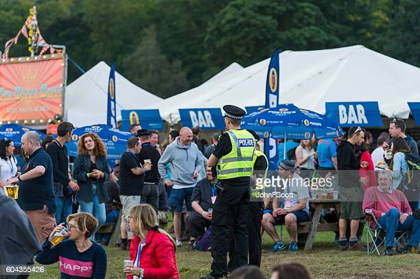 Police officers in the bar area of a music festival
