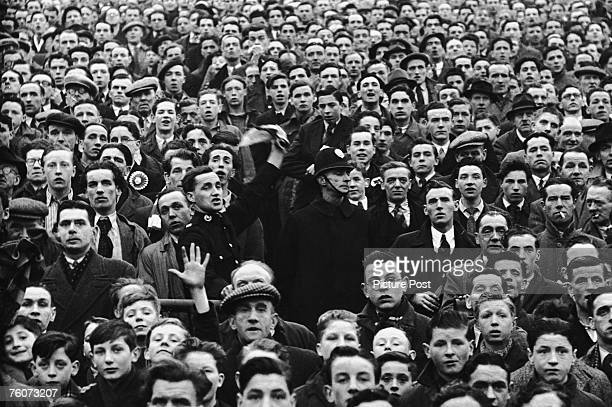 Police officers in the crowd at Ibrox during an Rangers vs Celtic Old Firm match 15th October 1949 Original Publication Picture Post 4894 Glasgow's...