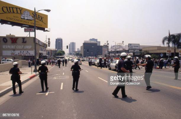 Police officers in the middle of Vermont Ave after widespread riots that erupted after the acquittal of 4 LAPD officers in the videotaped arrest and...