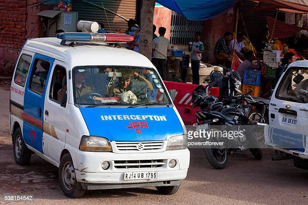 Police officers in vehicle on the streets of Jaipur, India