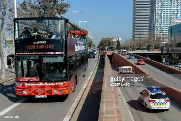 Police officers inspect a butane gas delivery truck which had to be shot to stop it in Barcelona on February 21 2017 Spanish police said today they...