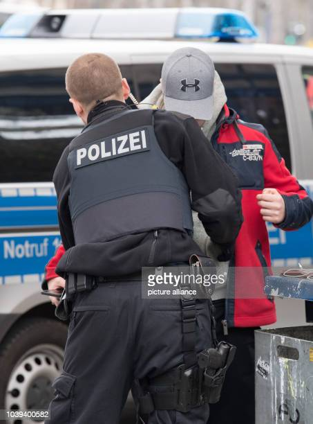 Police officers inspect a man during a control action against illegal passangers at the central bus station in Offenbach Germany 23 March 2017 A bus...