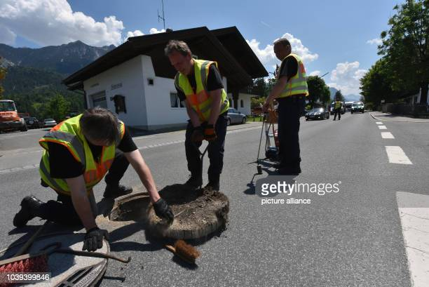 Police officers inspect and weld a manhole on the street in Kruen, Germany, 04 June 2015. German Chancellor Angela Merkel and USPresident Obama...