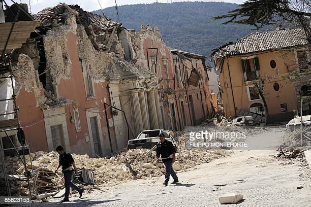 Police officers inspect buildings near the prefecture in the center of Abruzzo capital L'aquila, epicentre of an earthquake earlier in the day on...