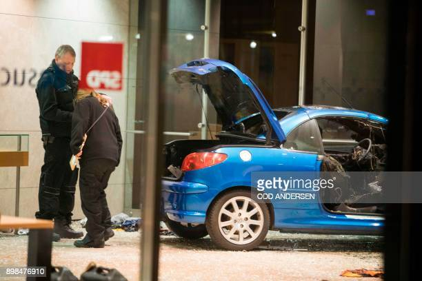 Police officers inspect damage in the lobby of the German Social Democratic Party headquarters after a car was used to ram the building in Berlin...