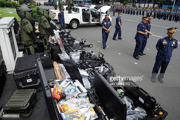 Police officers inspect explosive ordnance disposal equipment and vehicles donated by the US Anti-Terrorism Assistance Program, during a turnover...