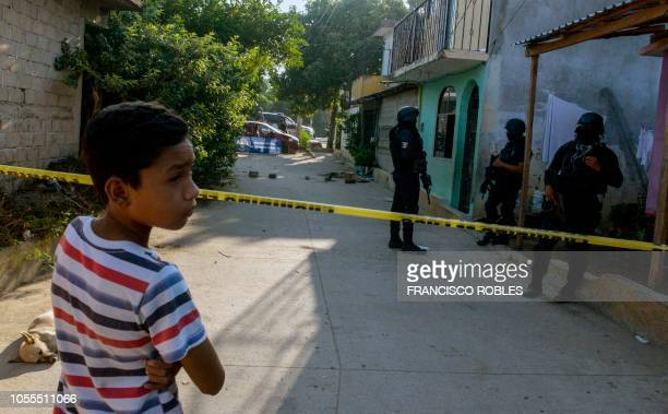 Police officers inspect La Saba area after a confrontation with an armed group during which five people were killed in Acapulco Guerrero State Mexico...