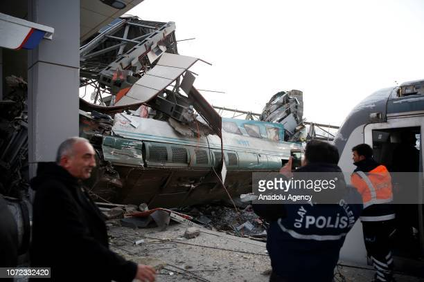 Police officers inspect the scene at the station after highspeed train crashed in Turkish capital Ankara on December 13 2018