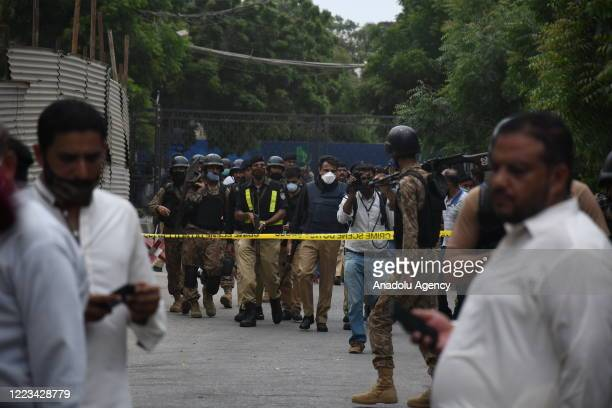 Police officers inspect the site after gunmen attacked the Pakistani stock exchange building in Karachi, Pakistan on June 29, 2020. At least nine...