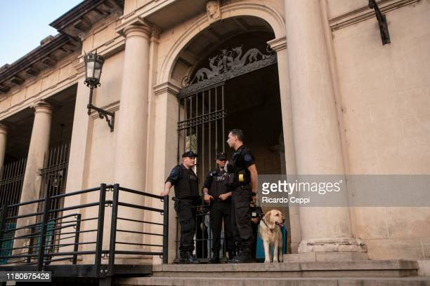 Police officers inspect the Universidad Nacional del Litoral building with explosivedetection dogs on October 12 2019 in Santa Fe Argentina The first...