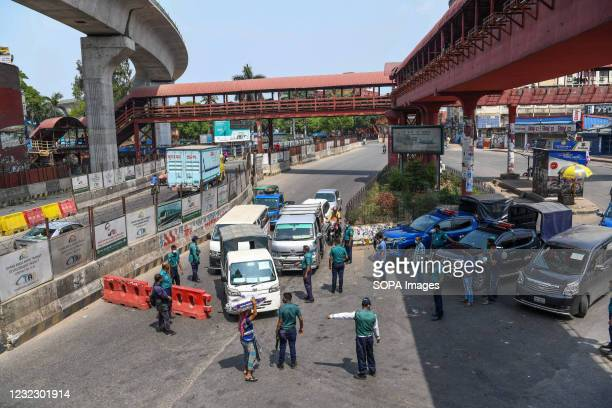 Police officers inspect vehicles at a checkpoint in Framgate. Police checkpoints are set up in various places in the capital to stop the unnecessary...
