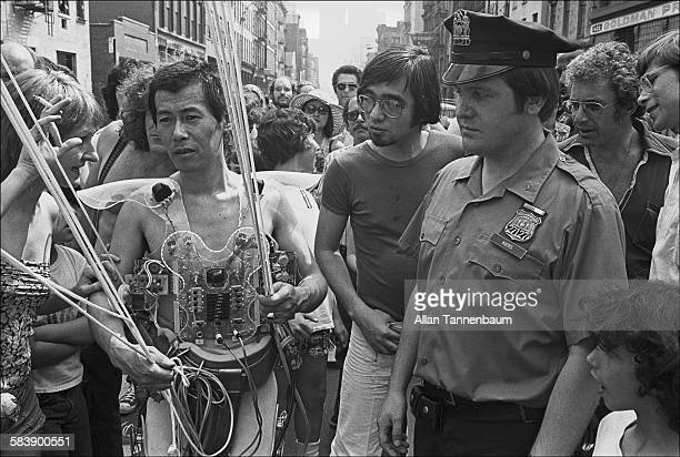 Police officers interrupt Japanese performance artist Minoru Yoshida before his planned attempt to launch himself via an elaborate system of ropes...