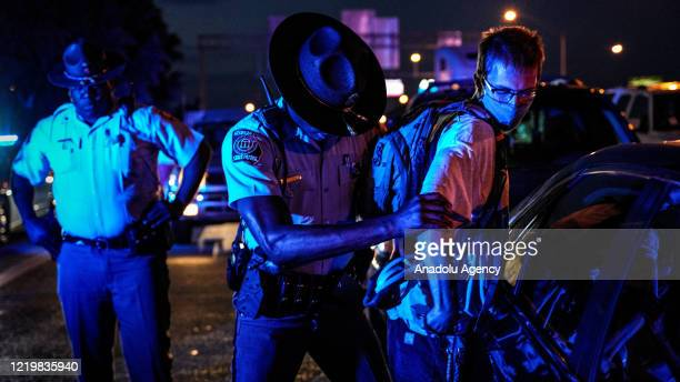 Police officers intervene demonstrators as demonstrators set on fire a restaurant during the protest after an Atlanta police officer shot and killed...