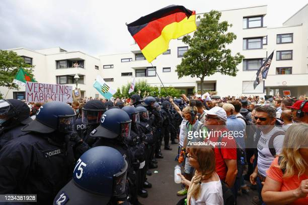 Police officers intervene in anti coronavirus vaccine protesters during a demonstration against the covid-19 restrictions of government in Berlin,...