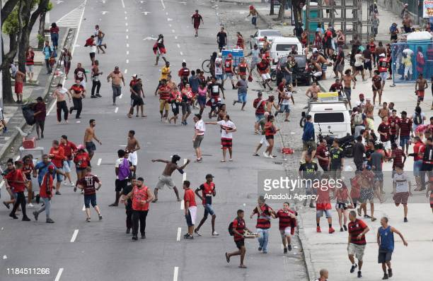 Police officers intervene in Flamengo fans during the celebration of Flamengo's Copa CONMEBOL Libertadores title in Candelaria downtown of Rio de...