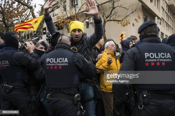Police officers intervene in protesters during a protest against judicial ruling ordering the city's museum to return 44 pieces of religious art to...