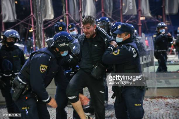 Police officers intervene protesters during the rally against a ban on movements which was extended by the government to curb the spread of the novel...