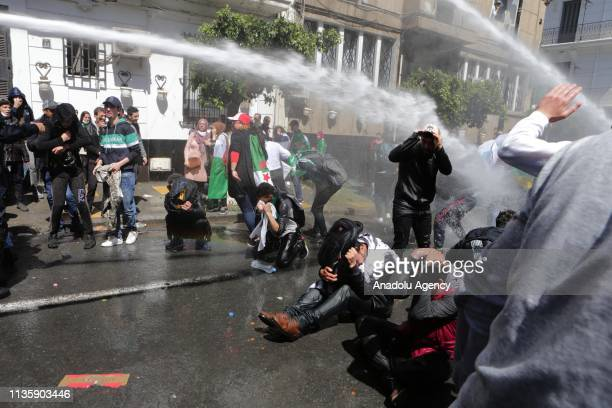 Police officers intervene protesters with pressurized water during a demonstration against interim president Abdelkader Bensaleh in Algiers Algeria...