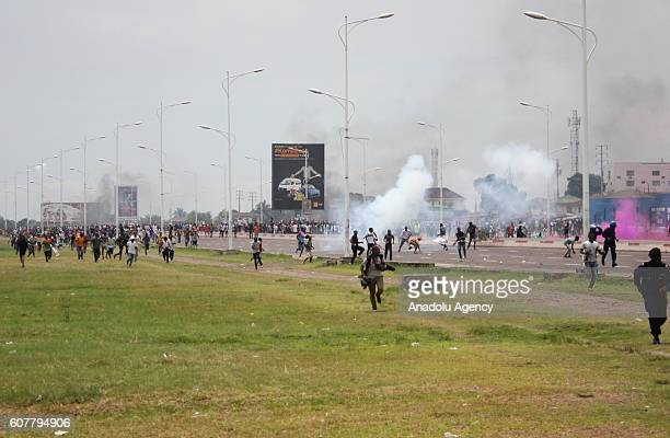 Police officers intervene to protesters during a protest against President of the Democratic Republic of the Congo Joseph Kabila in Kinshasa...