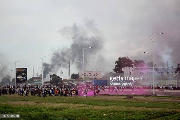 Police officers intervene to protesters during a protest against President of the Democratic Republic of the Congo Joseph Kabila, in Kinshasa,...