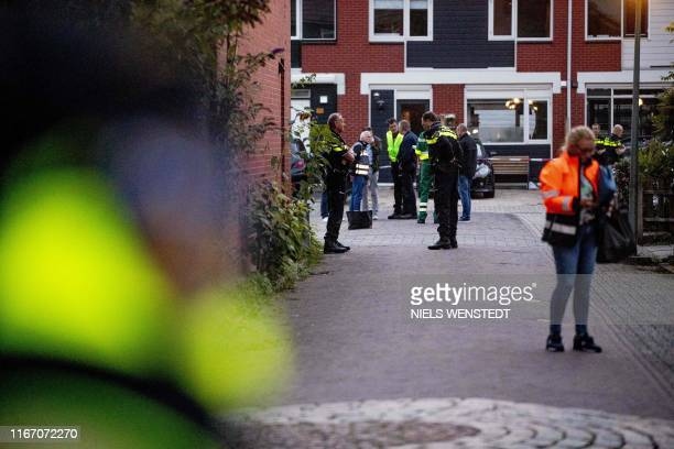 Police officers investigate a house, after a shooting incident in which three persons were killed, in Dordrecht, on September 9, 2019. - At least...