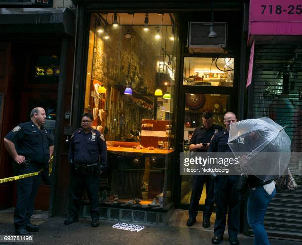Police officers investigate a robbery at a jewelry store May 25, 2017 in downtown Brooklyn, New York. Jewelry stores are often targets for thieves...