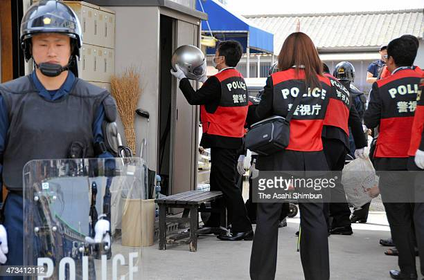 Police officers investigate an office of the Kudokai Yakuza syndicate on May 15 2015 in Fukuoka Japan The raid was held on suspicion of the violation...