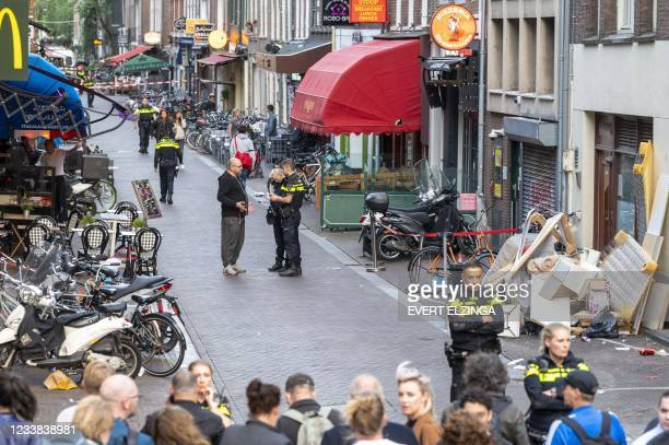 Police officers investigate Lange Leidsedwarsstraat, the site of an attack during which a Dutch journalist specialised in crime, Peter R. De Vries...