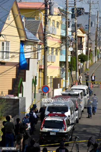 Police officers investigate the apartment building where body parts of 9 people were found on November 2 2017 in Zama Kanagawa Japan