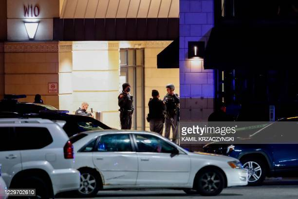 Police officers investigate the area at the Mayfair Mall in Wauwatosa, Wisconsin, on November 20, 2020. - Multiple people were injured in a shooting...
