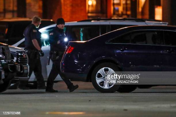 Police officers investigate the area outside the Mayfair Mall in Wauwatosa, Wisconsin, on November 20, 2020. - Multiple people were injured in a...