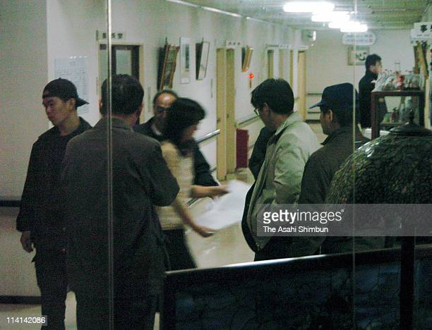 Police officers investigate the cause of norovirus at the nursing home Fukuyama Fukujuen on January 7 2005 in Fukuyama Hiroshima Japan