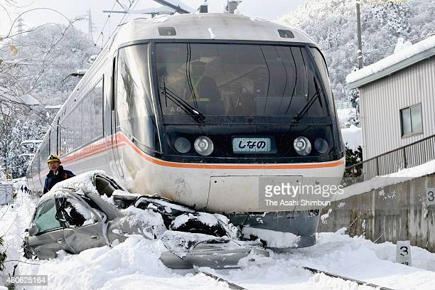 Police officers investigate the cause of the accident between the express train 'Super View Shinano' and a car on December 18 2014 in Nagano Japan No...