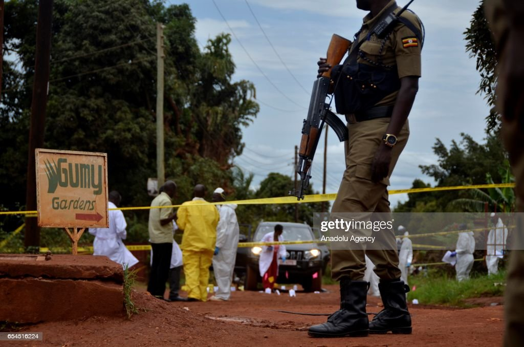 Police officers investigate the crime scene after Assistant Inspector General Andrew Felix Kaweesi was shot dead just 100 meters from his home in Kulambiro, a suburb of the capital Kampala, Uganda on March 17, 2017. Two people riding a motorcycle reportedly shot the vehicle from behind, forcing the driver to stop, and then showered it bullets, killing all three passengers.