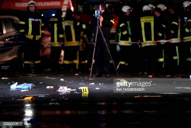 Police officers investigate the place where a man drove into a carnival procession on February 24 2020 in Volkmarsen near Kassel central Germany...