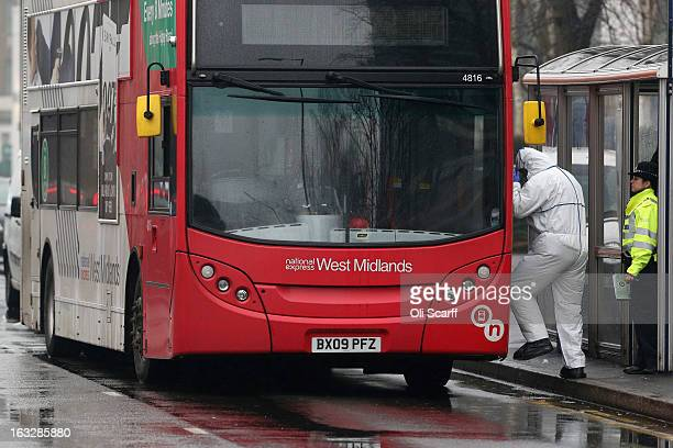 Police officers investigate the scene of a fatal stabbing of a 15 year old girl on a bus in Birmingham city centre on March 7 2013 in Birmingham...